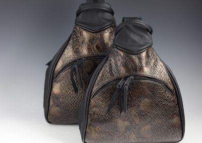 Large and Small Sling Pack Comparison: Front View