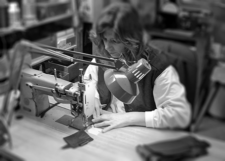 Judy Sewing a Leather Bag